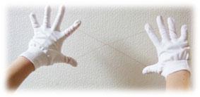 糸で脱毛する糸除毛の手の形